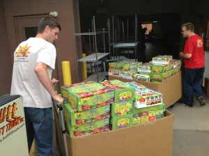 Kids Food Basket volunteers unloading pallets full of juiceboxes